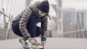 Woman-Tying-Her-Shoes
